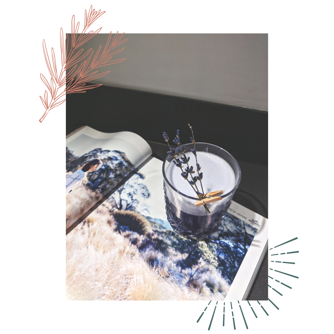 a lavender cocktail on top of a magazine image with a desert background